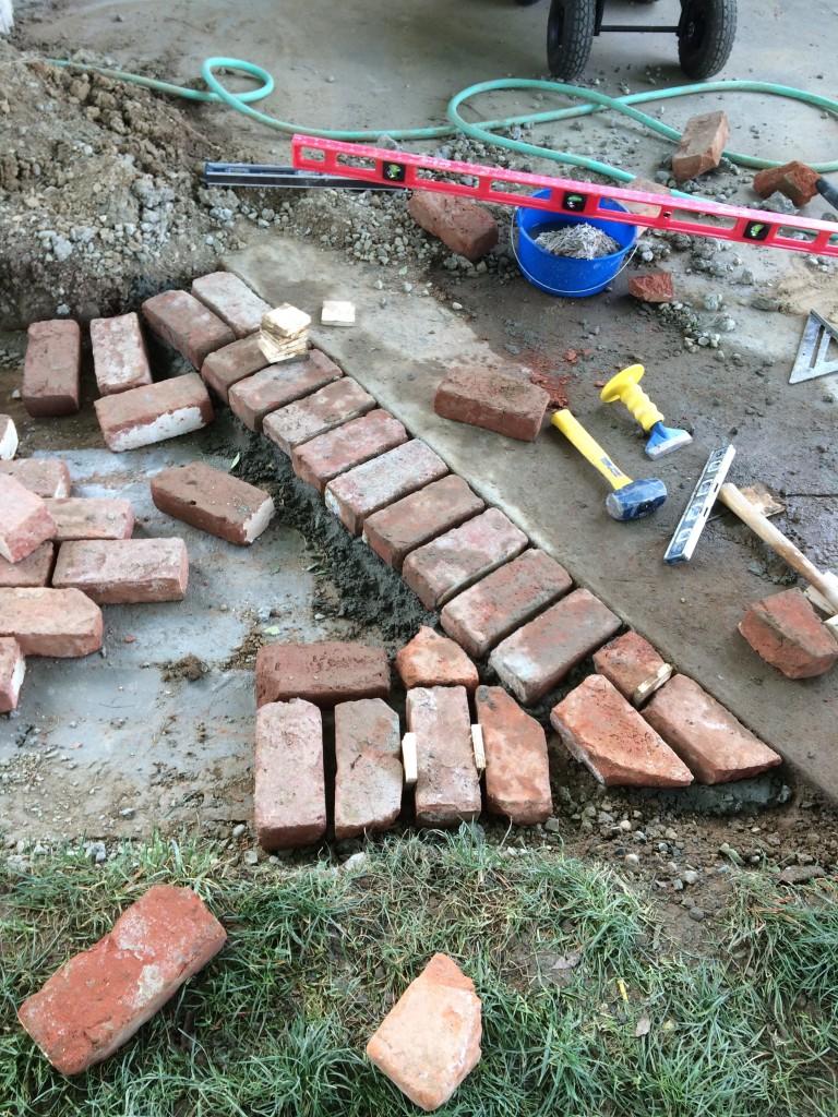 First few bricks.